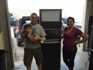 Clients posing with Photo Booth