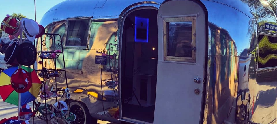 Jessica Morgan Our first weekend with 2 events was insanely hectic and crazy! Here is our set up from the first event! Beautiful prime booth that is glowing inside of the camper!